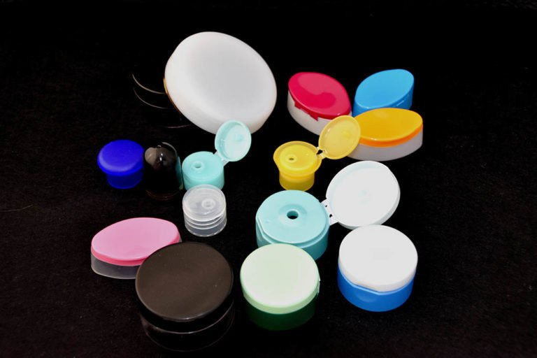 Plastic caps for use in cosmetics